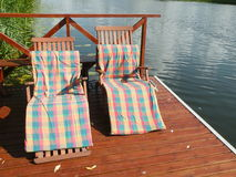 Two chair. With cover near riwer, relax Stock Images