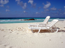 Two chair on the beach. Two chairs on the white sand beach Stock Image