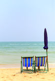 Two chair on the beach with Umbrella Stock Image