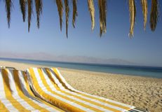 Two chair below umbrella. Egypt Nuweiba - view of two chair below umbrella on the beach royalty free stock photo