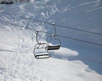 Two chair-lift with snowdrift in sun morning Stock Photography