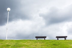 two chair and on a meadow with green grass and blue sky Royalty Free Stock Photos