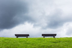 two chair on a meadow with green grass and blue sky Stock Photo