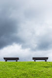 two chair on a meadow with green grass and blue sky Stock Image