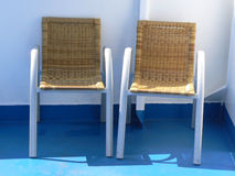 Two chairs. On ferry deck Stock Photos