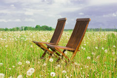 Two chairs. In the grassland Stock Photo