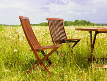 Two chairs. And table in the grassland Stock Photography