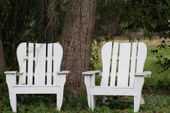 Two Chairs. Two empty chairs in rural yard Royalty Free Stock Photos
