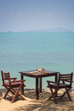 Two Chairs And Table At A Beach Close To Ocean Stock Images