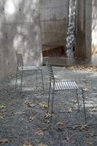 Two chairs arranged in the park background Stock Photography