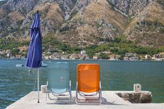 Two chairs on the beach. Montenegro. pier. royalty free stock photography