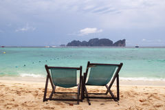 Two chairs on a beach near to sea. Royalty Free Stock Photography