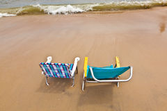 Two chairs at the beach for relaxing Royalty Free Stock Photos
