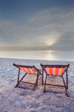 Two chairs beach and sunset Royalty Free Stock Photography