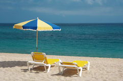 Two chairs and beach umbrella royalty free stock photography