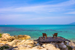 Two chairs on the beach in the wooden board Royalty Free Stock Photos