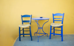 Two chairs and blue table on the terrace Stock Photos