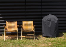 Two chairs and a covered grill Royalty Free Stock Photo