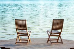 Two chairs on dock Royalty Free Stock Image