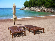 Two chairs on empty beach Royalty Free Stock Photography