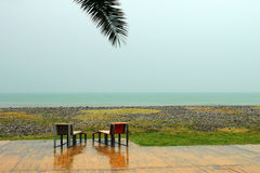 Two chairs on empty beach at rainy day in Batumi, Georgia Stock Image
