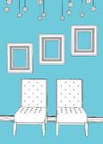 Two chairs with empty frames in blue interior Stock Images