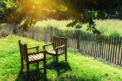 Two chairs exposed at sunlight Stock Photos
