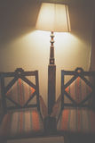 Two chairs and floor lamp Royalty Free Stock Photo