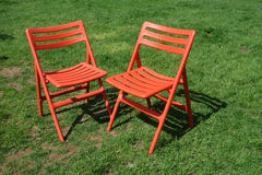 Two Chairs on the Grass Stock Photos