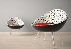 Two chairs on a grey wall Stock Image