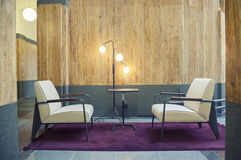 Two chairs. In hall of office building Royalty Free Stock Image