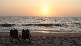 Two chairs near coastline stock footage