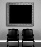 Two chairs  near  wall Royalty Free Stock Photo