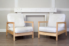 Two chairs and ornate decorative plaster moldings Stock Photos