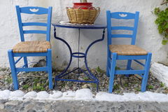 Two chairs outside a Greek restaurant. In te traditional blue and white Royalty Free Stock Photography
