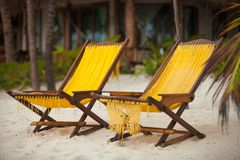 Two chairs on perfect tropical white sand beach in Stock Photography