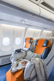 Two chairs prepared to sleep in the airplane salon (vertical) Royalty Free Stock Photos