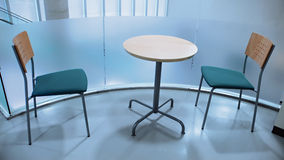 Two chairs and round table Stock Photos