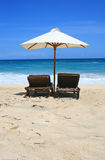 Two chairs on the sea. Two chairs and umbrella on the sea stock photo