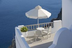 Two chairs with the sea view. Oia, Santorini, Greece. Stock Image