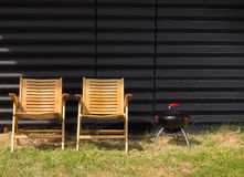 Two chairs and a small barbeque Royalty Free Stock Photography