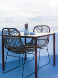 The two chairs and a small table on beautiful terrace with wonderful sea view. The two chairs and a small table on beautiful terrace with sea view stock photography