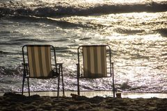 The seashore on the sand are two chairs stock photo