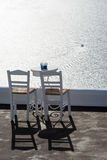 Two chairs, table and amazing view on Aegean sea, Santorini, Greece Stock Photography
