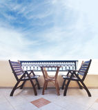 Two chairs and a table on the balcony: Santorini resort Royalty Free Stock Photos