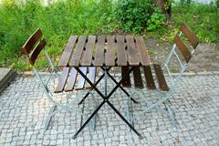Two chairs and table in beer garden Stock Photography