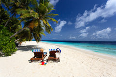 Two chairs on tropical beach, family vacation Stock Images