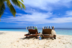 Two chairs on the tropical beach Royalty Free Stock Photography