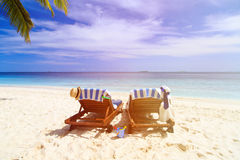 Two chairs on the tropical beach Royalty Free Stock Photos
