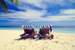 Two chairs on the tropical beach Stock Photos